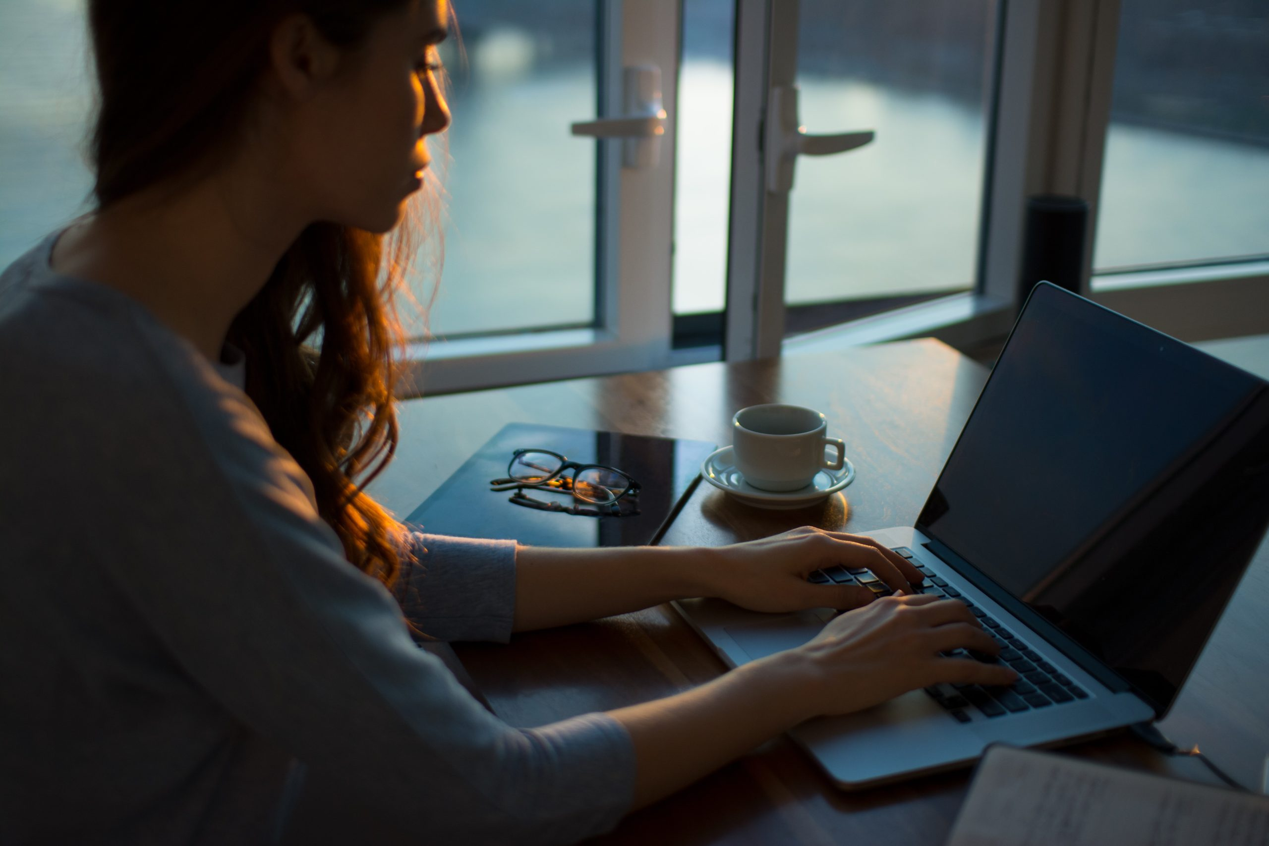 woman in financial distress looking at a laptop